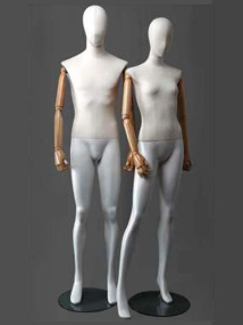 Female mannequin faceless head and wooden hands